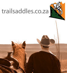 The trailsaddles logo above a cowboy looking into the distance with his saddled horse. The cowboy wears a Stetson Hat