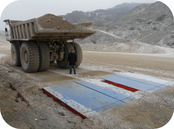 a mining truck moving off of a weighbridge