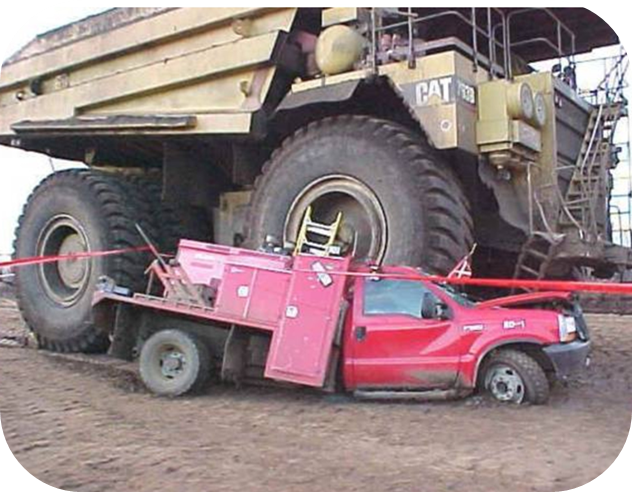 A photo of a mining vehicle on a car